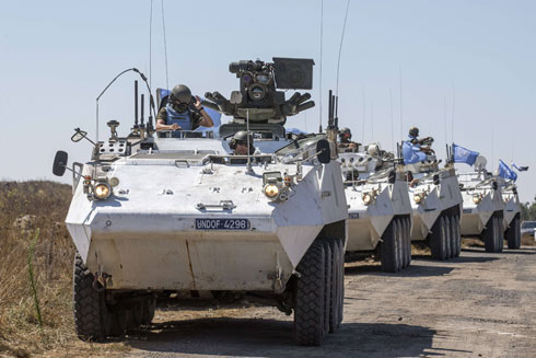 Filipino UN peacekeepers crossing the border from Syria to Israel (Photo: AFP)