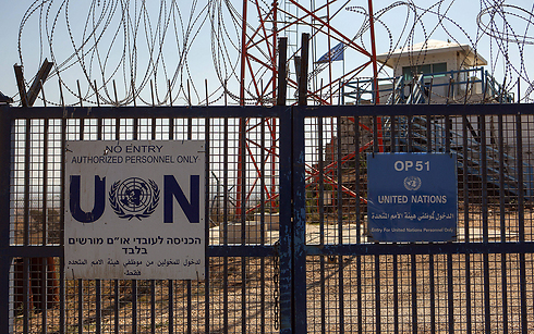 The entrance gate to the UN base in Quneitra