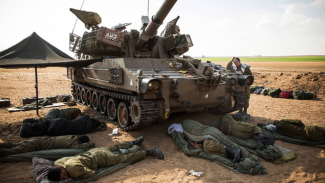 IDF troops sleeping next to their tank on the Gaza border during the 2014 war  (Photo: Getty Images)