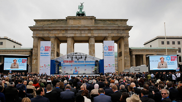Angela Merkel speaking at the Berlin rally. (Photo: Reuters) (Photo: Reuters)