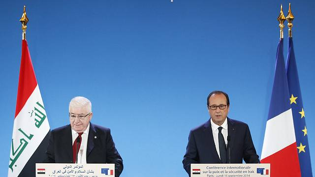 French President Hollande and Iraqi counterpart Masum at the International Conference for Peace and Security in Iraq (Photo: EPA)