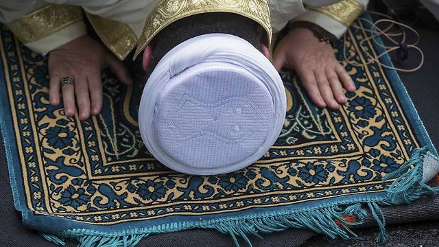 An Imam performs Friday prayers (Photo: Reuters) (Photo: Reuters)