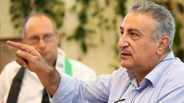 Dr. Kamal Al-Labwani visiting Israel (Photo: AFP)