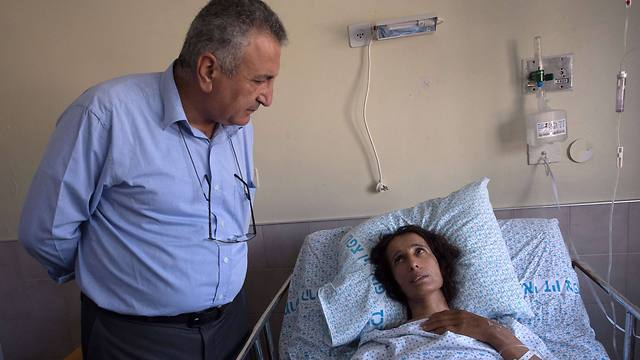 Dr. Kamal Al-Labwani visiting the Ziv Medical Center in Safed, where wounded from the Syrian civil war are being treated (Photo: AFP)
