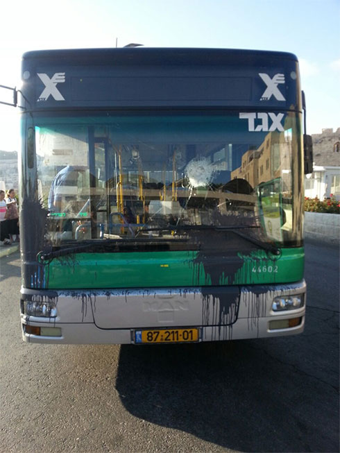 Damage caused to the bus from stones and paint bottle thrown at it.