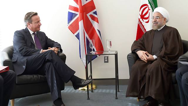 British Prime Minister David Cameron with Iran's President Hassan Rouhani (Photo: Reuters) (Photo: Reuters)
