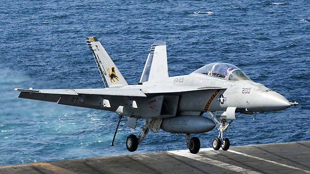 F-18 landing after bombing ISIS targets (Photo: MCT)