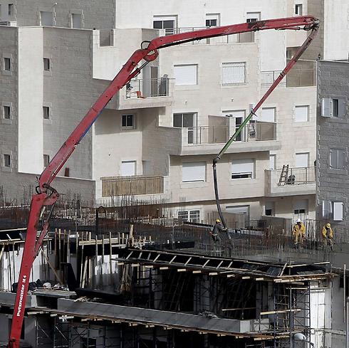 """בנייה בבירה. """"להכיר את העובדות"""" (צילום: AFP) (צילום: AFP)"""