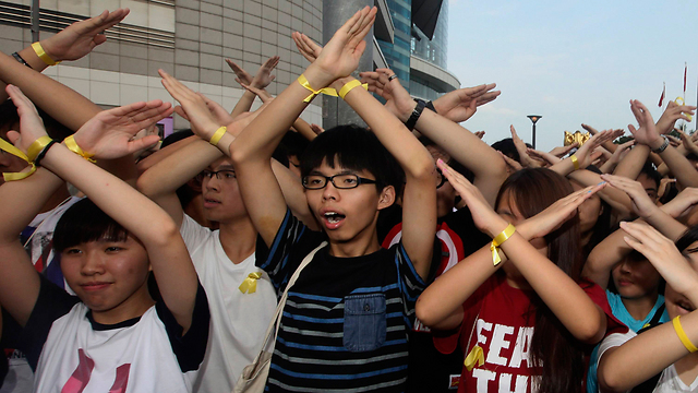 Joshua Wong with protesters in Hong Kong: 'We hope there will be no violence.' (Photo: Reuters) (Photo: Reuters)