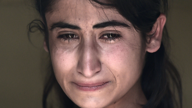 Kurdish refugee (Photo: AFP)