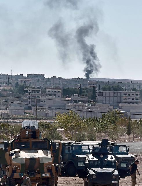 Kurdish smoke outside Kobani (Photo: AFP)