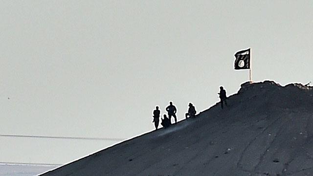 Islamic State flag over Kobani (Photo: AFP)