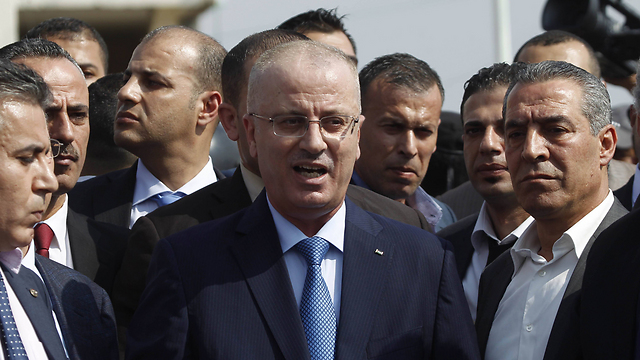 Palestinian Prime Minister Rami Hamdallah in a 2014 visit to Gaza (Photo: AFP) (Photo: AFP)