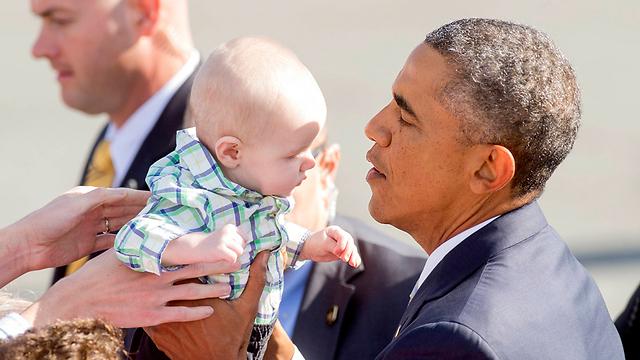 Kissing babies: Obama in San Francisco last month. (Photo: AP) (Photo: AP)
