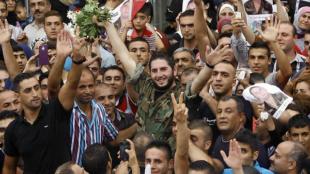 Lebanese army soldier Wael Darwish, who was captured by militants in August in Arsal, celebrates after his release (Photo: AP)