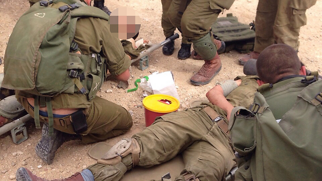 Wounded soldiers receiving treatment on the scene of the attack.