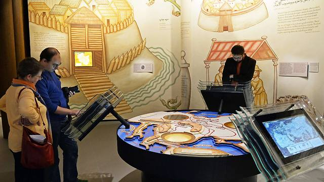 Visitors discover an exhibition in the Museum of the History of Polish Jews (Photo: AFP)