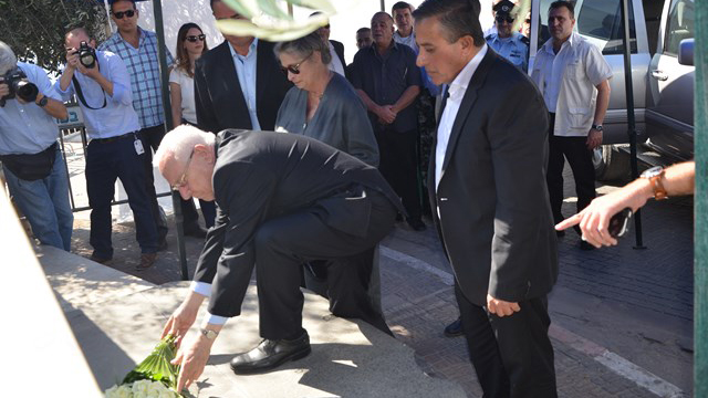 President Reuven Rivlin lays a wreath at the memorial for the 1956 massacre of Arabs in Kafr Kassem