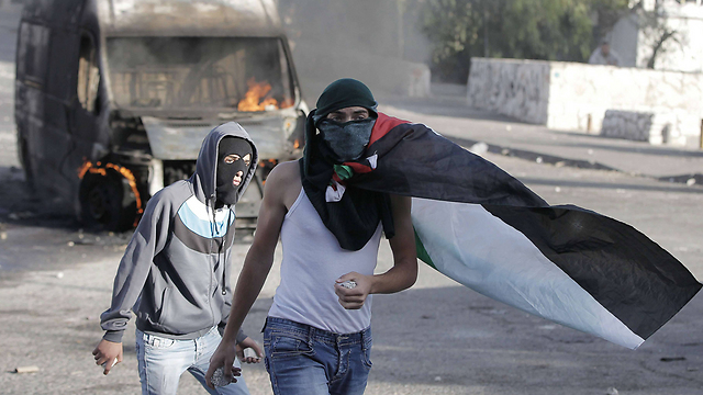 Palestinian rioters with stones in hand riot during increased violence in Jerusalem. (Photo: AFP) (Photo: AFP)