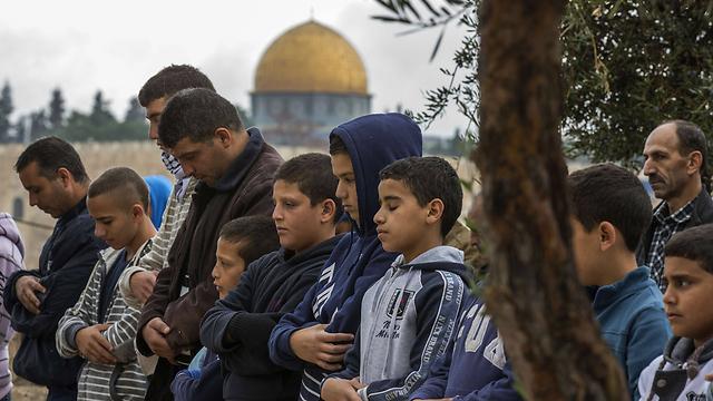 Palestinians at Friday prayers near the Temple Mount in Jerusalem (Photo: AFP) (Photo: AFP)