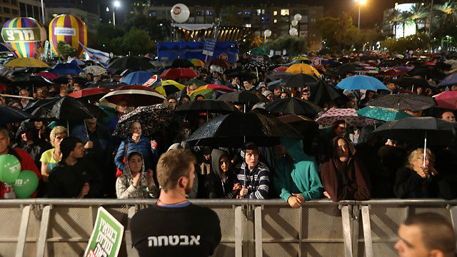 Rain did not deter the thousands that attended the rally (Photo: Yaron Brener)
