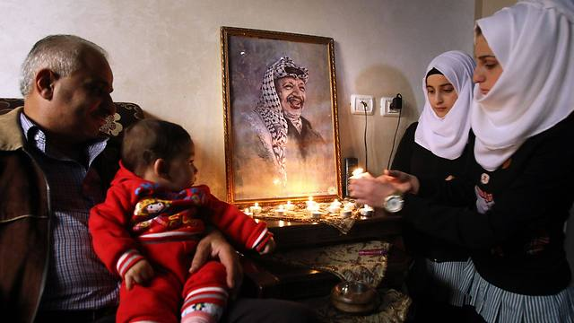 Palestinians remember late president Yasser Arafat on the 10 year anniversary of his death. (Photo: AFP)
