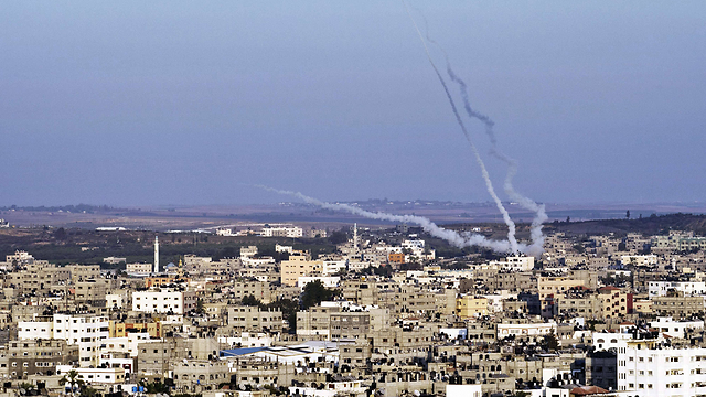 Smoke trails from rockets fired from urban area of Gaza during Operation Protective Edge (Photo: AFP)