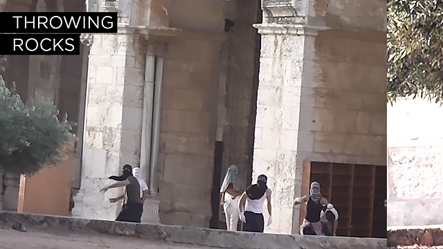 A photo shows Palestinian rioters throwing rocks from al-Aqsa mosque at Israeli police patrolling the area. (Photo: Israel Police) (Photo: Israel Police)