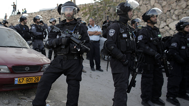 Police gathered at the entrance to the Issawiya neighborhood in Jerusalem. (Photo: AFP)