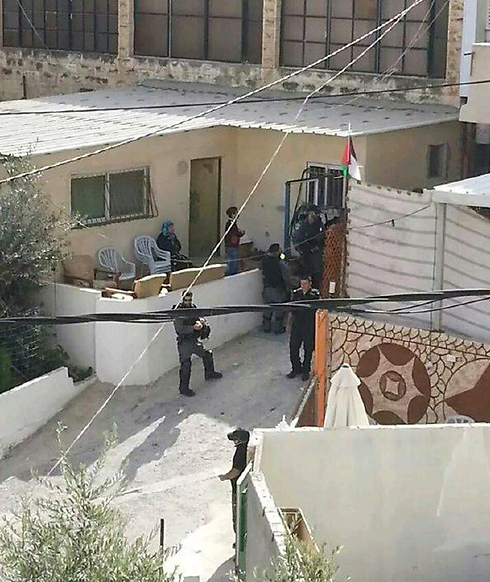 Israeli police take measurments at home of terrorist's family who stabbed and killed Dalia Lemkus on Monday.