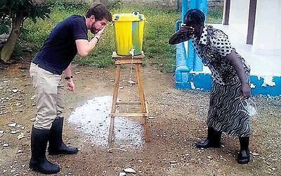 Voni Glick outside a Sierra Leone clinic. 'There's chlorine at every entrance. You have to wash your hands.' (Photo:IsraAID)