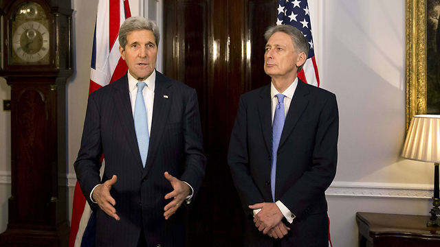 US Secretary of State with UK Foreign Secretary Philip Hammond in November 2014. (Photo: AFP)