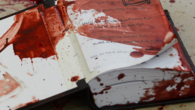 A bloodstained prayer book at the synagogue (Photo: GPO) (Photo: GPO)