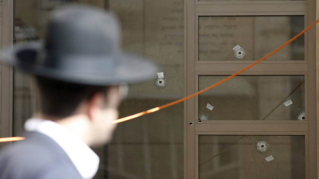 Bullet holes at Kehilat Bnei Torah synagogue in Jerusalem following attack (Photo: AFP) (Photo: AFP)