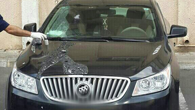 The car damaged in the acid attack (Photo: Israeli police sources)