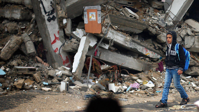 Rain-soaked rubble (Photo: Reuters) (Photo: Reuters)