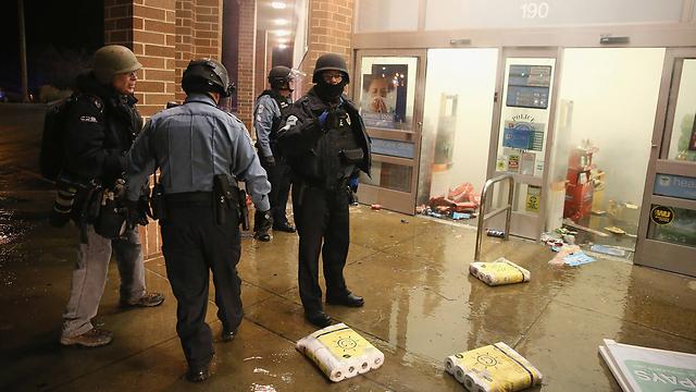 אירועי ביזה (צילום: AFP) (צילום: AFP)