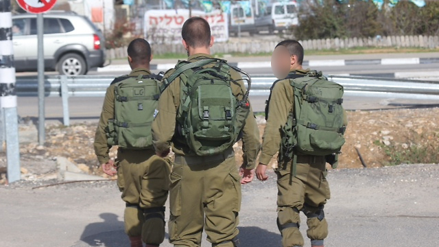 Soldiers from the Duchifat Battalion of the Kfir Brigade at the scene of the stabbing. (Photo: Motti Kimchi) (Photo: Motti Kimchi)