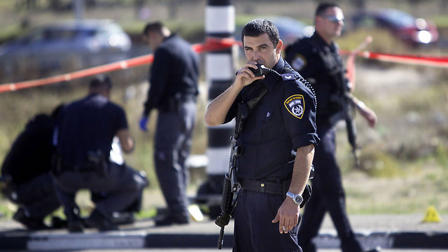 Israel police at the scene of the stabbing attack in the West Bank. (Photo: Associated Press) (Photo: Associated Press)