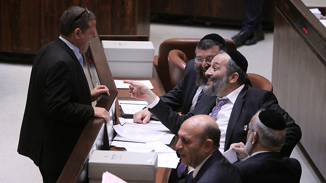 Labor MK Cabel laughs with Haredi factions (Photo: Knesset)