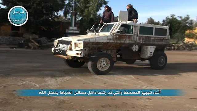 The Al-Nusra Front using the UN vehicle for the attack. (Photo: Twitter) (Photo: Twitter)