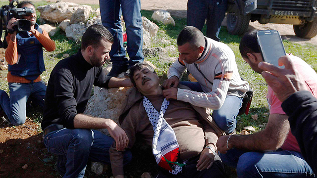 Abu Ein after he collapsed, in the West Bank (Photo: Reuters) (Photo: Reuters)