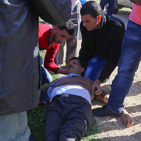 Abu Ein after he collapsed, in the West Bank (Photo: Reuters) (Photo: EPA)