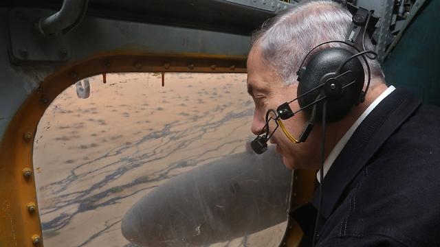 Prime Minister Benjamin Netanyahu flies over the Evrona  oil spill