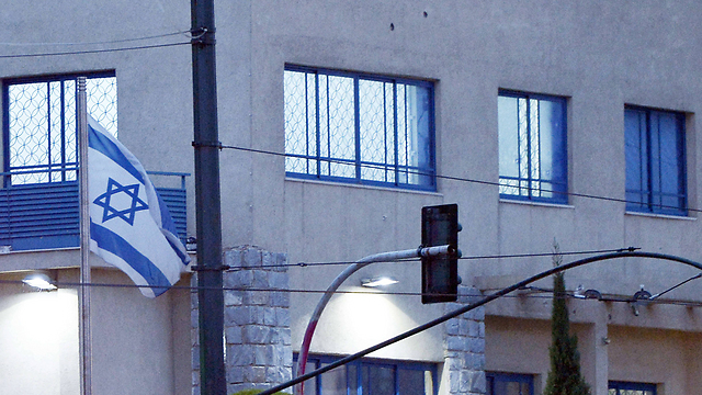 Bullet holes in embassy (Photo: AFP)