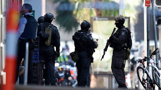 Security forces outside cafe (Photo: EPA)