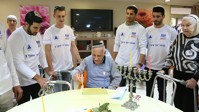 Released IDF soldiers light first candle of Hanukkah at the Gil Oz retirement home in Petah Tikva. (Photo: Yaron Brenner) (Photo: Yaron Brenner)
