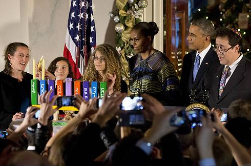 President Barack Obama and First Lady Michelle Obama light menorah with children from Hand in Hand school (Photo: AP)