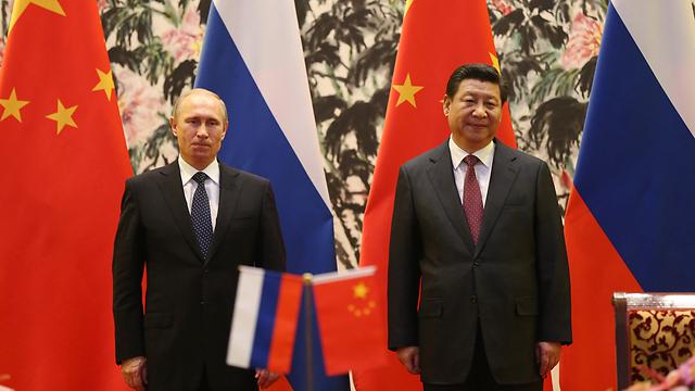 """""""אתה לא חייב להיות רזה כמו אובמה"""". נשיא סין שי ונשיא רוסיה פוטין (צילום: Gettyimages)"""