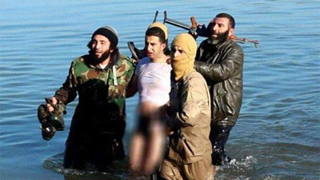 The Jordanian pilot being taken in by members of the Islamic State terrorist group.